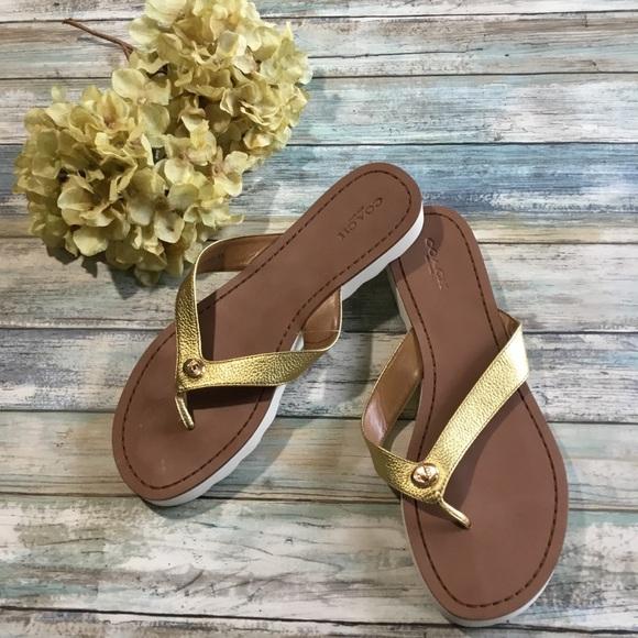 7009a500e7e8 Coach Shoes - Coach Shelly Turnlock flip flops NWOT